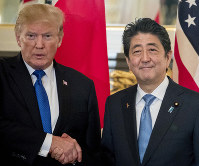 In this Nov. 6, 2017, file photo, U.S. President Donald Trump, left, and Japanese Prime Minister Shinzo Abe shake hands before a bilateral meeting at the Akasaka Palace in Tokyo. (AP Photo/Andrew Harnik)