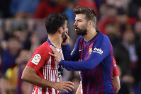 Barcelona's Gerard Pique, right, talks to Atletico forward Diego Costa as he tries to calm him after he was sent off with a red card for insulting referee Jesus Gil Manzano during a Spanish La Liga soccer match between FC Barcelona and Atletico Madrid at the Camp Nou stadium in Barcelona, Spain, on April 6, 2019. (AP Photo/Manu Fernandez)