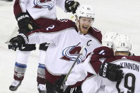 Colorado Avalanche left wing Gabriel Landeskog (92) celebrates his goal with teammates during the first period of Game 5 against the Calgary Flames in an NHL hockey first-round playoff series on April 19, 2019, in Calgary, Alberta. (Dave Chidley/The Canadian Press via AP)