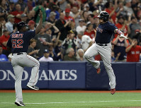 Boston Red Sox's Christian Vazquez, right, celebrates with third base coach Carlos Febles after hitting a two-run home run off Tampa Bay Rays relief pitcher Ryan Yarbrough during the fifth inning of a baseball game on April 19, 2019, in St. Petersburg, Fla. (AP Photo/Chris O'Meara)