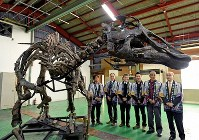 A life-size replica of Japan's largest fossilized dinosaur skeleton is unveiled to the press in the town of Mukawa, Hokkaido, on April 11, 2019. (Mainichi/Kan Takeuchi)