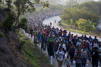 Central American migrants, part of a caravan hoping to reach the U.S. border, move on the road in Escuintla, Chiapas State, Mexico, Saturday, April 20, 2019. (AP Photo/Moises Castillo)