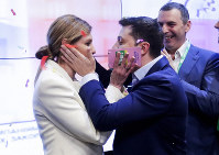 Ukrainian comedian and presidential candidate Volodymyr Zelenskiy, and his wife Olena Zelenska congratulate each other at his headquarters after the second round of presidential elections in Kiev, Ukraine, on April 21, 2019. (AP Photo/Sergei Grits)