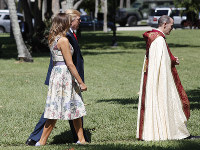 President Donald Trump with first lady Melania Trump, walk behind the Rev. James R. Harlan, right, as they arrive for Easter services at Episcopal Church of Bethesda-by-the-Sea, on April 21, 2019, in Palm Beach, Fla. (AP Photo/Pablo Martinez Monsivais)