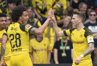Dortmund's scorer Marco Reus celebrates his goal with Axel Witsel, left, during the German Bundesliga soccer match between SC Freiburg and Borussia Dortmund in Freiburg, Germany, on April 21, 2019. (Patrick Seeger/dpa via AP)