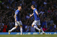 Everton's Lucas Digne, left, celebrates scoring against Manchester United with teammate Seamus Coleman during the English Premier League soccer match at Goodison Park, Liverpool, England, on April 21, 2019. (Martin Rickett/PA via AP)