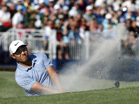 C.T. Pan blast out of a bunker on 17 during the final round of the RBC Heritage golf tournament at Harbour Town Golf Links on Hilton Head Island, S.C., on April 21, 2019. Pan won with a 12-under par for his first PGA victory. (AP Photo/Mic Smith)