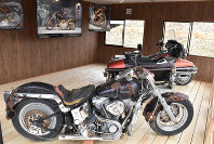 Two Harley Davidson bikes that were damaged in the tsunami are displayed in Yamamoto, Miyagi Prefecture, on April 21, 2019. The photos on the walls are of the