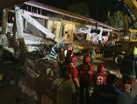 Workers continue rescue operations on people still trapped inside a collapsed building at Porac town, Pampanga province, northern Philippines, on April 22, 2019. (AP Photo/Bullit Marquez)