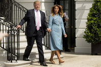 U.S. President Donald Trump and first lady Melania Trump arrive for the annual White House Easter Egg Roll on the South Lawn of the White House on April 22, 2019, in Washington. (AP Photo/Andrew Harnik)