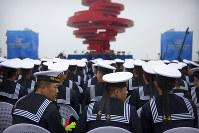 Chinese sailors sit during a concert featuring Chinese and foreign military bands in Qingdao, on April 22, 2019. (AP Photo/Mark Schiefelbein)