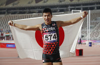Japan's Yoshihide Kiryu celebrates after the men's 100-meters final race at the Asian Athletics Championships in Doha, Qatar, on April 22, 2019. (AP Photo/Vincent Thian)