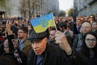 Supporters of Ukrainian President Petro Poroshenko, who have come to thank him for what he did as a president, listen to his speech in Kiev, Ukraine, on April 22, 2019. (AP Photo/Vadim Ghirda)