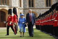 In this July 13, 2018 file photo, U.S. President Donald Trump and Britain's Queen Elizabeth inspects the Guard of Honour at Windsor Castle in Windsor, England. (AP Photo/Pablo Martinez Monsivais)