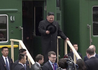 In this image from a video released by Primorsky Regional Administration Press Service, North Korean leader Kim Jong Un gets off a train upon arrival at Khasan train station in Primorye region, Russia, on April 24, 2019. (Primorsky Regional Administration Press Service via AP)