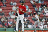 Boston Red Sox's Chris Sale stands on the mound after giving up a solo home run to Detroit Tigers' Grayson Greiner, right, during the fifth inning in the first game of a baseball doubleheader in Boston, on April 23, 2019. (AP Photo/Michael Dwyer)
