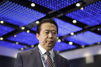 In this July 4, 2017, file photo, Interpol President, Meng Hongwei, walks toward the stage to deliver his opening address at the Interpol World Congress in Singapore. (AP Photo/Wong Maye-E)