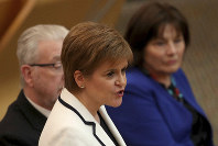 First Minister of Scotland Nicola Sturgeon issues a statement on Brexit and independence in the main chamber at the Scottish Parliament, Edinburgh, on April 24, 2019. (Jane Barlow/PA via AP)