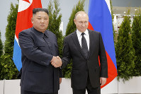 Russian President Vladimir Putin, right, and North Korea's leader Kim Jong Un shake hands during their meeting in Vladivostok, Russia, on April 25, 2019. (AP Photo/Alexander Zemlianichenko, Pool)