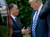 In this June 1, 2018 file photo, U.S. President Donald Trump, right, shakes hands with Kim Yong Chol, former North Korean military intelligence chief and one of leader Kim Jong Un's closest aides, after their meeting in the Oval Office of the White House in Washington. (AP Photo/Andrew Harnik)