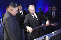 Russian President Vladimir Putin, right, presents a Korean sword to North Korea's leader Kim Jong Un during their meeting in Vladivostok, Russia, on April 25, 2019. (Alexei Nikolsky, Sputnik, Kremlin Pool Photo via AP)