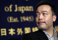 In this Jan. 22, 2015, file photo, Kosuke Tsuneoka, a Japanese freelance journalist, looks on before a news conference at the Foreign Correspondents' Club of Japan in Tokyo. (AP Photo/Eugene Hoshiko)