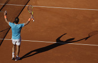 Spain's Rafael Nadal raises his racket on the court after winning his men's singles match against Argentina's Leonardo Mayer at the Barcelona Open Tennis Tournament in Barcelona, Spain, on April 24, 2019. The final score was 6-7, 6-4, 6-2. (AP Photo/Manu Fernandez)