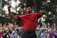 Tiger Woods reacts as he wins the Masters golf tournament on April 14, 2019, in Augusta, Ga. (AP Photo/David J. Phillip)