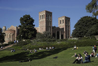 Students sit on the lawn near Royce Hall at UCLA on April 25, 2019, in Los Angeles. (AP Photo/Jae C. Hong)