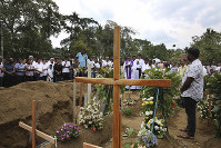 A priest conducts a funeral service for a victim of Easter Sunday's bomb blast at St. Sebastian's Church, in Negombo, Sri Lanka on April 25, 2019. (AP Photo/Manish Swarup)