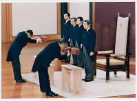 New Emperor Akihito, right, takes part in the Kenji-to-Shokei-no-Gi ceremony to inherit the Imperial Regalia and the State and Privy seals as proof of his succession to the throne, at the