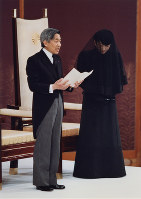 New Emperor Akihito accompanied by new Empress Michiko makes his first speech as part of the Sokui-go-Choken-no-Gi ceremony, the first public ceremony after his accession, at the
