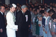 Emperor Akihito and Empress Michiko speak to bereaved families of the victims of the Battle of Okinawa in 1945 at the Okinawa Peace Hall in the city of Itoman, Okinawa Prefecture, on April 23, 1993 during the first ever visit by an emperor to Okinawa. (Mainichi)