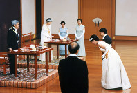 Emperor Akihito and Empress Michiko, left, receive a greeting from Crown Prince Naruhito and Crown Princess Masako, right, just after the latters' wedding ceremony, at the