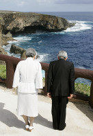 Emperor Akihito and Empress Michiko offer a silent prayer at Banzai Cliff, where many Japanese refused to surrender to U.S. forces and jumped into the sea to their deaths in 1944 while praising Emperor Hirohito, the father of Akihito, on the Pacific island of Saipan on June 28, 2005. (Pool photo)