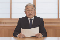 Emperor Akihito expresses his apparent desire to abdicate at a reception room in the Imperial Palace in Tokyo on Aug. 7, 2016. The recorded video message was shown to the public on TV the next day. (Photo courtesy of the Imperial Household Agency)