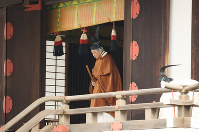 Emperor Akihito steps out after the