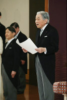 Emperor Akihito reads his final statement at the