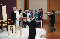 The Imperial Regalia of Japan are presented before the beginning of Emperor Akihito's