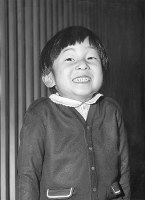 Prince Hiro (Naruhito) grins about the birth of Prince Aya (Fumihito) at his residence at the Togu Palace on Nov. 30, 1965. (Pool photo)