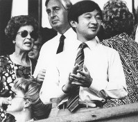 Prince Hiro (Naruhito), center, watches the Wimbledon tennis championship final from the royal box at center court, in London, on July 8, 1984, during his overseas study trip to Britain. (UPI)