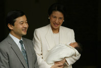 Newborn Princess Aiko and Crown Princess Masako accompanied by Crown Prince Naruhito leave the Hospital of the Imperial Household on the Imperial Palace grounds in Tokyo, on Dec. 8, 2001. (Pool photo)
