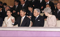 From left, Crown Princess Masako, Crown Prince Naruhito, Emperor Akihito, and Empress Michiko attend a concert held by high-ranking officials of the Imperial Household Agency to celebrate the 30th anniversary of the Emperor's enthronement and the Imperial Couple's 60th wedding anniversary, at a hall in the Imperial Palace in Tokyo, on April 2, 2019. (Pool photo)