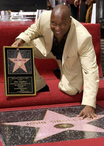 100baada6 In this Aug. 26, 2003 file photo, director John Singleton touches his new  star on the Hollywood Walk of Fame in Los Angeles. Oscar-nominated  filmmaker John ...