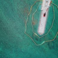 埋め立て工事が進む辺野古周辺。周囲は青い海に囲まれている=沖縄県名護市で2019年4月22日午後0時11分、小型無人機で森園道子撮影
