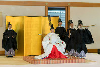 In this photo released by Imperial Household Agency of Japan, Japan's Emperor Naruhito attends a ritual of dispatching imperial envoys to the Ise Grand Shrine, and mausoleums of the late emperors to report the dates of his enthronement ceremonies, at the Imperial Palace in Tokyo, on May 8, 2019. (Imperial Household Agency of Japan via AP)