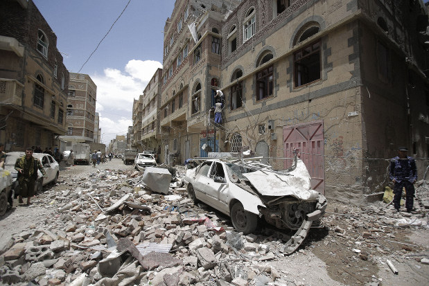 People inspect the site of an airstrike by the Saudi-led coalition in Sanaa, Yemen, on May, 16, 2019. (AP Photo/Hani Mohammed)