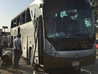 Officials jack up a bus that was damaged by a bomb, in Cairo, Egypt, on May 19, 2019. (AP Photo/Mohammed Salah)
