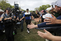 Brooks Koepka walks to the 10th tee during the final round of the PGA Championship golf tournament, on May 19, 2019, at Bethpage Black in Farmingdale, N.Y. (AP Photo/Charles Krupa)