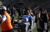 Referee Victor Hugo Hurtado is transported off the field to the hospital after fainting during a soccer game between the Always Ready team and Oriente Petrolero team, part of the 'Apertura' local soccer tournament in El Alto, Bolivia, on May 19, 2019. (AP Photo/Juan Carlos Usnayo)